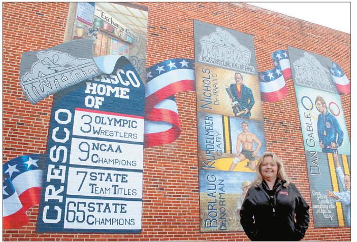 An artist meets a wrestling program through community mural