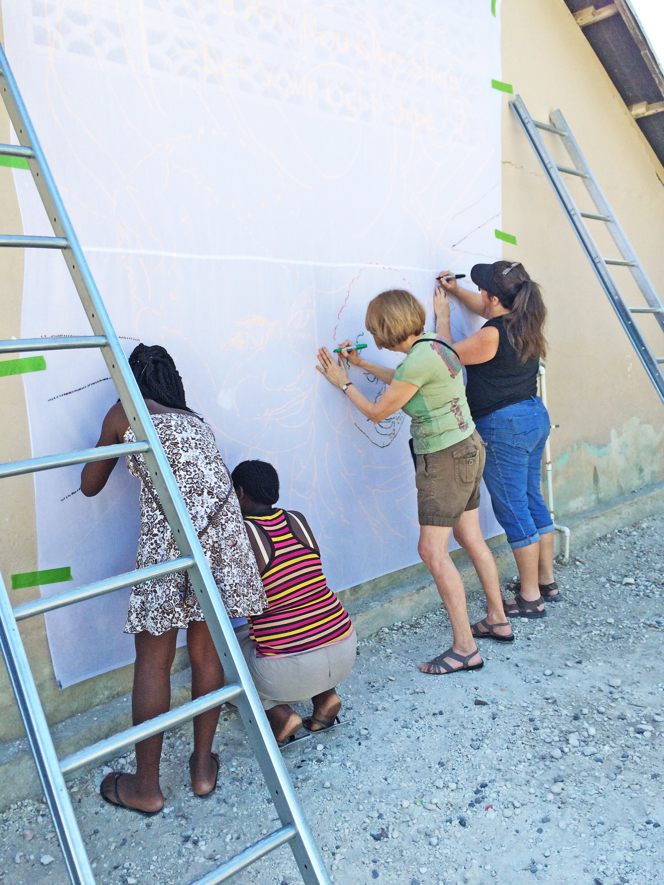 Shining light brightens Haitian walls