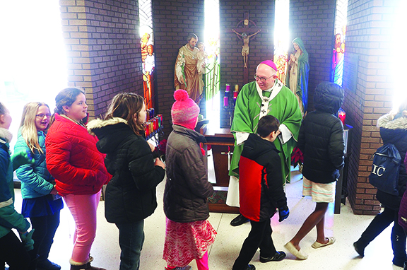 Archbishop delivers message of caring to IC students