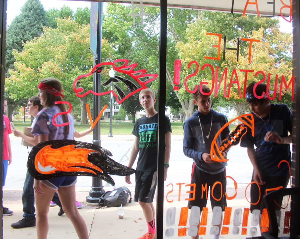 GALLERY: Students wash town in orange and black