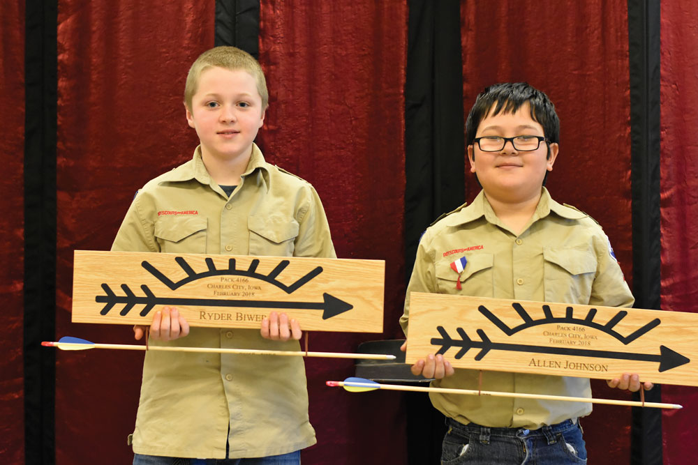 Two Scouts earn the the Arrow of Light