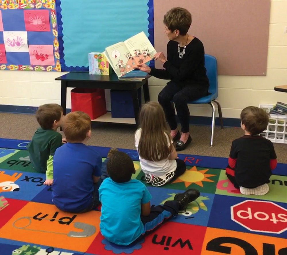 Volunteer readers share stories at TLC