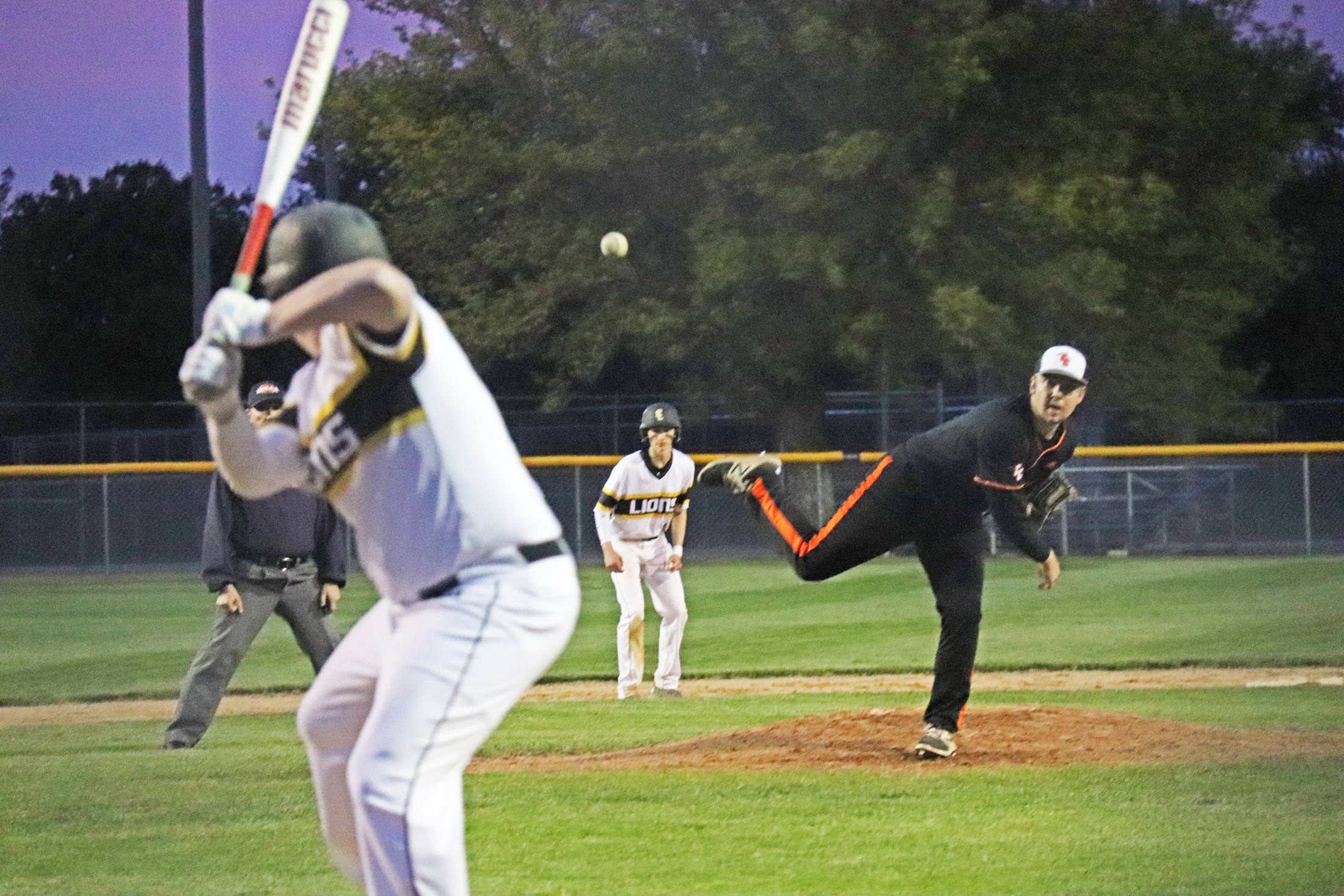 Lions rally past Comets, 14-4, in baseball opener
