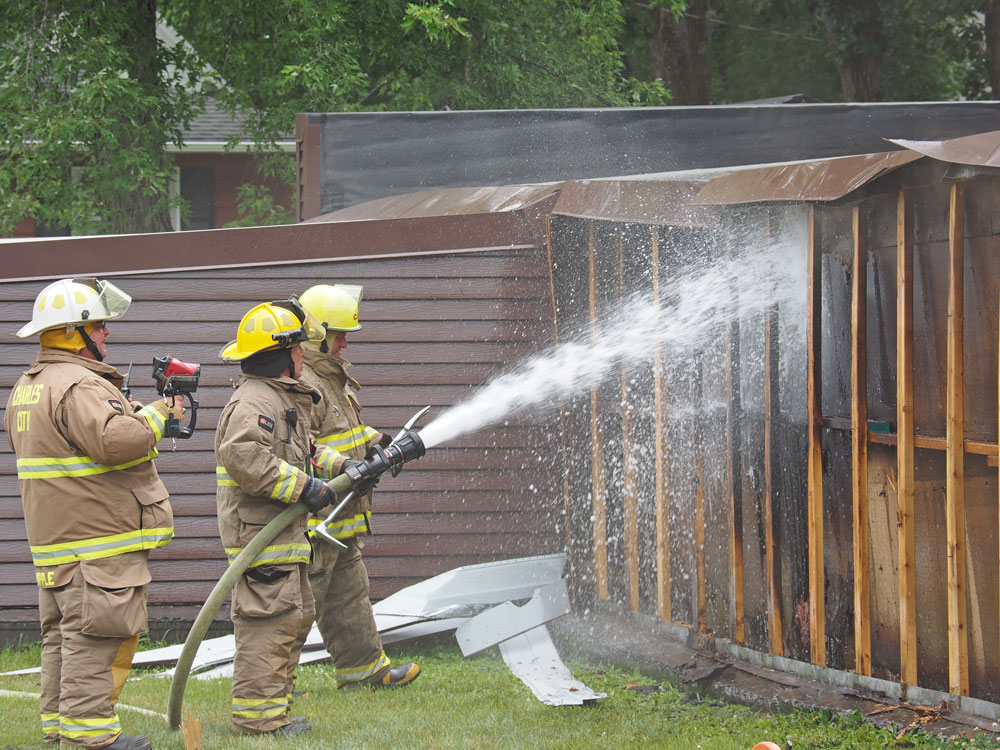 Firefighters extinguish small Charles City garage fire Wednesday afternoon