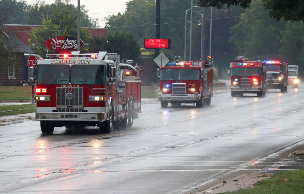 Caravan through town honors Charles City firefighter