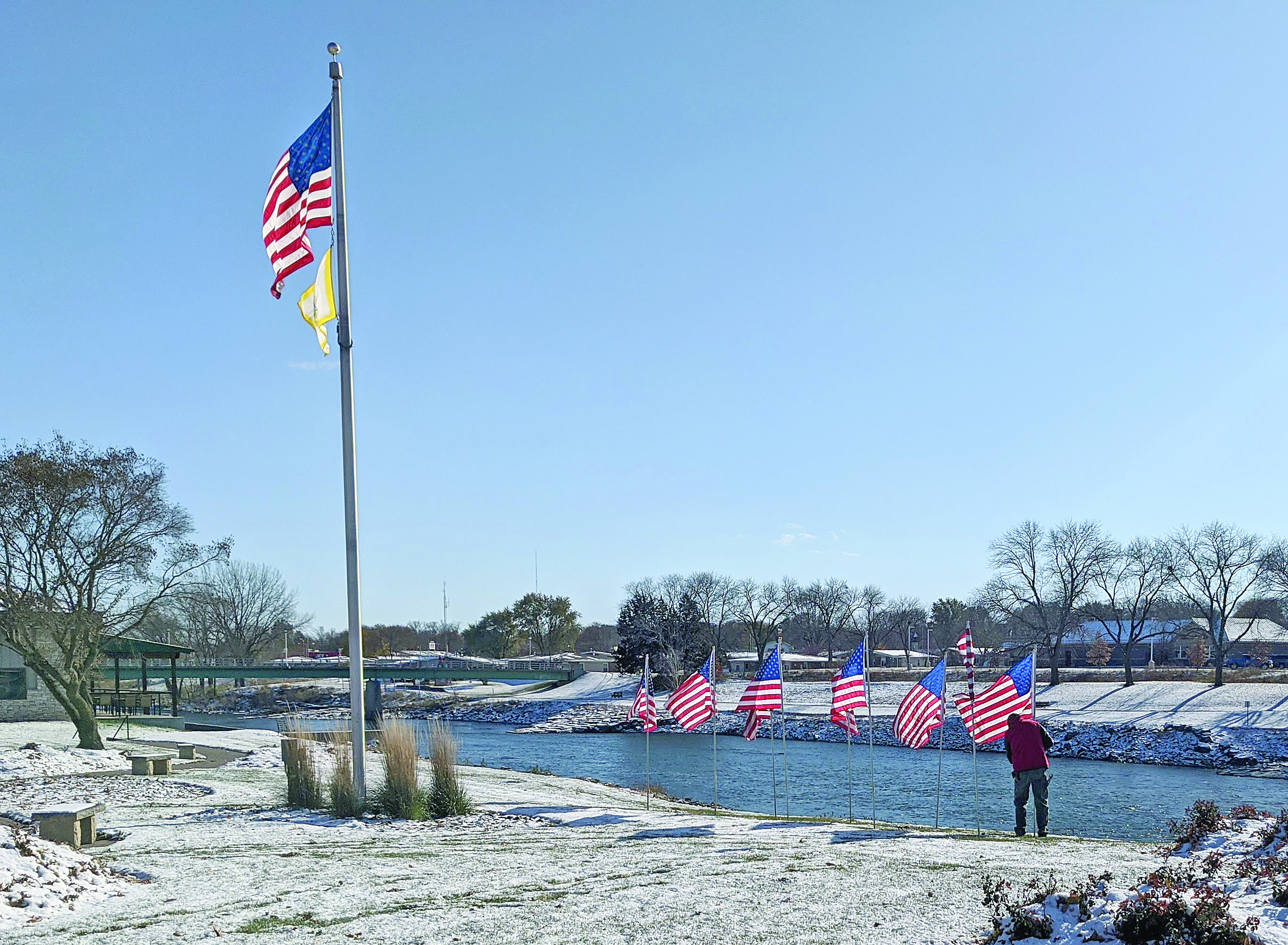 Early snow makes Veterans Day flag display a little more challenging
