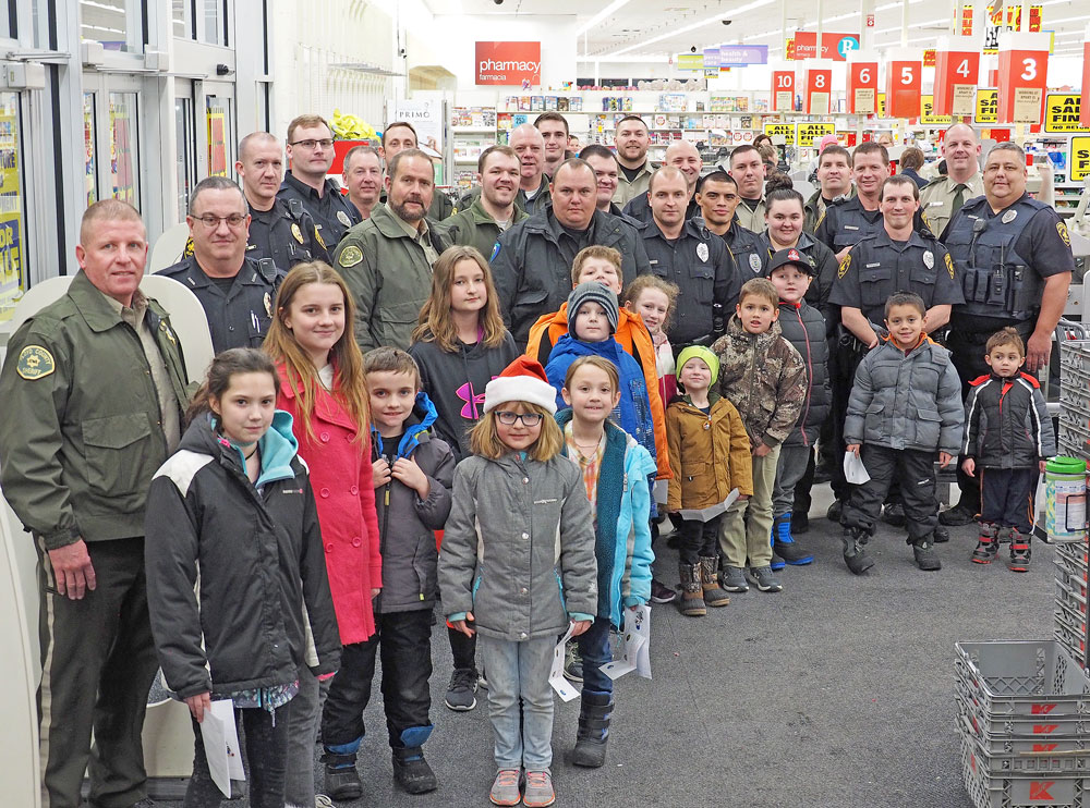 Kids get to Shop With A Cop for extra gifts this Christmas