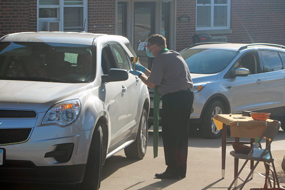 St. John holds drive-thru communion service