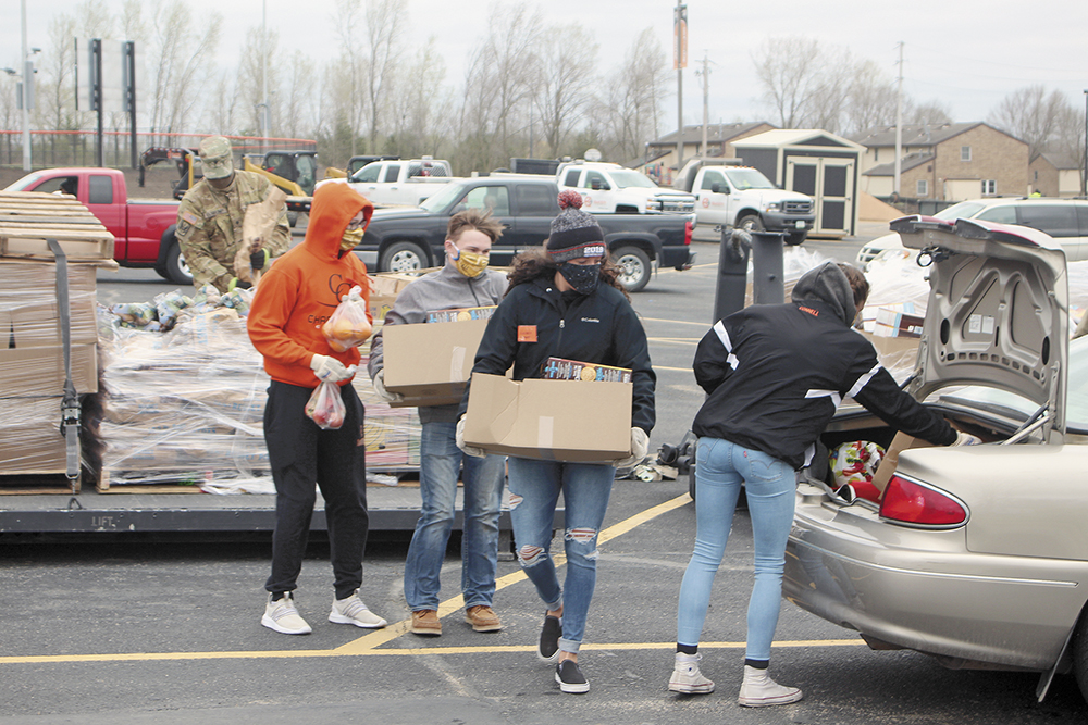 Food distribution at Charles City High School parking lot Wednesday evening